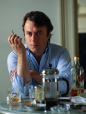 "Leading Atheist  ""thinker""Christopher Hitchens doing what he does not  best: cigarettes and drinking.  European colonial expansion has secured liberal notions of ""freedom"" exclusively the  white race  which is secured from the oppression of people of color."